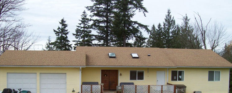 Yellow House with Deck and Garage